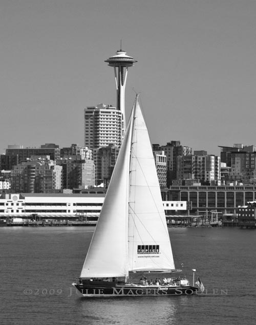 black and white photo of sailboat in Elliott Bay and Seattle Space Needle