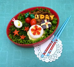 birthday boy bento (gamene) Tags: birthday potatoes tomatoes egg broccoli onigiri chopsticks carrot bento doily katsu ceese