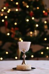Christmas Communion (Garibaldi McFlurry) Tags: christmas white set silver bread lights miniature blood wine bokeh body jesus christmastree christian tablecloth mass communion anglican chalice paten eucharist sacrament holycommunion lordssupper homecommunion