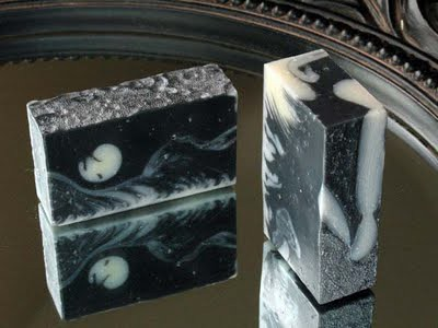 black and white soap bars, made with activated charcoal. The swirl is irregular and creates splodges and streaks of white in a largely black field.