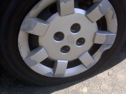 CC-licensed photo of a flat tire.