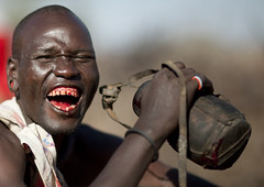 Samburu man smiling after drinking one liter of cow blood - Kenya (Eric Lafforgue) Tags: africa portrait people face cow blood drink kenya african culture tribal human tribes afrika remote tradition tribe ethnic tribo gens visage afrique ethnology tribu eastafrica 5379 qunia lafforgue ethnie ethny  qunia    kea    humainpersonne a