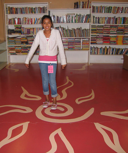 Goodwill Ambassador Laura proudly showing the library.