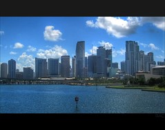 Miami Skyline (Louie, Lou) Tags: city sky urban water skyline architecture clouds buildings bay downtown cityscape florida miami sunny highrise condos puffy hdr rac miamiheat biscaynebay downtownmiami aprtments americanairlinesarena readyaimclick mcarthurcswy