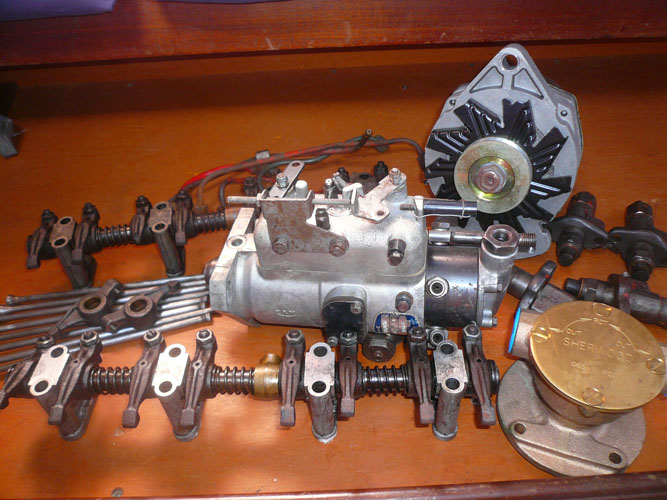 Spare motor parts - Rods, 2 Rocker assemblies and 2 rocker arms, fuel injection pump, water pump, 4 injectors (cleaned and checked in Aug 08), and the spare alternator