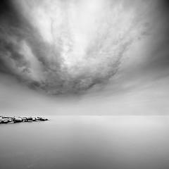 Incoming (Mute*) Tags: longexposure bw lake toronto storm water clouds rocks lakeontario canonef1740mmf4lusm vertorama