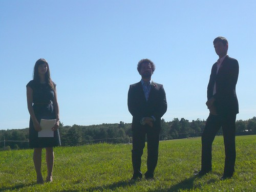 Backlit Trio (officiant, groom, best man)