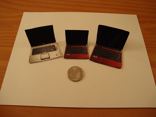 Our laptop cake toppers made out of scaled down photographs of our laptops