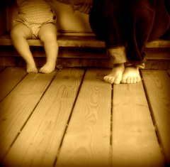 Just the two of them.... (Candice Compton Robertson) Tags: door wood blue blackandwhite bw baby white black love feet girl sepia foot boards holding hands toddler shadows friendship jane compton kentucky painted mommy daughter mother mama jeans together matilda porch barefoot bebe denim candice toenails robertson memoir topseven mywinners inspiredbygod