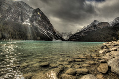 Hint of Sun (Vinnyimages) Tags: trip lake canada mountains fall tourism water canon landscape hotel scenery hiking tripod scenic roadtrip glacier alberta lakeshore boating banff canon5d canoeing lakelouise popular hdr breathtaking touristattraction banffnationalpark parkscanada 1740l victoriaglacier photomatic outdoorphotography fairmontchateaulakelouise nationparks lakelouisevillage platinumheartaward october2009 vinnyimages wwwvinnyimagescom vinnyimagescom