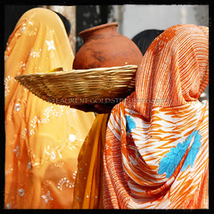 An Orange Delight (designldg) Tags: people orange woman india fashion square colours veil silk culture atmosphere panasonic fabric soul varanasi shanti saree sari benares benaras garment femininity sarees uttarpradesh ramnagar  corporeal indiasong dmcfz18