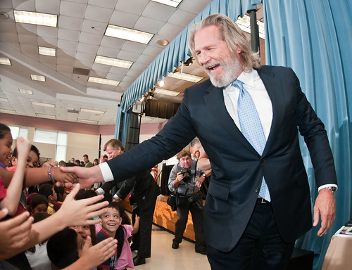 "Academy Award Winner and No Kid Hungry National Campaign Spokesperson Jeff Bridges, and other speakers at the Virginia No Kid Hungry Campaign launch, shake the hands of students at the Barcroft Elementary School in Arlington, VA, on Tuesday, June 7, 2011. One of the speakers, Agriculture Secretary Tom Vilsack said, "" We know our strength comes from out partnerships…"" Campaign partners include Share our Strength, the Federation of Virginia Food Banks, corporate partners, education leaders, government agencies and community organizations. The Virginia Summer Meals for Kids Program is funded by the USDA and provides free summer meals at hundreds of sites across the Commonwealth of Virginia, but according to a new report released today by the Food Research and Action Center, more than 80 percent of those eligible do not participate. Governor McDonnell (behind Bridges) announced and stressed that all parents who want free meals for their kids in need, can simply call 211 to find a summer meals site near them. USDA Photo by Lance Cheung."