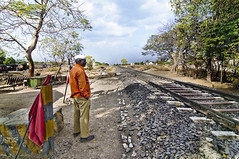 The Indian Railways Lineman in Earthy Red at Meherabad (Anoop Negi) Tags: red portrait india train photography for photo media crossing image photos earth stones delhi indian bangalore creative engine rail pebbles images best line earthy level po mumbai railways anoop baba negi meherabad meher photosof ezee123 bestphotographer imagesof anoopnegi jjournalism
