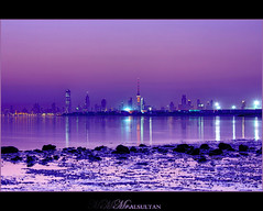 Kuwait Cityscape !  Before sunrise ... Explored !! (mr.alsultan) Tags: sea beach canon eos cityscape purple kuwait xsi q8 freezone   450d   mralsultan