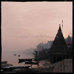 The Wings of my Song (designldg) Tags: travel pink sunset india reflection heritage water mystery river spectacular square temple photography evening boat heaven poem colours dusk magic perspective culture atmosphere panasonic silence soul ethereal varanasi spiritual shanti hindu kashi contrejour ganga supernatural ganges ghats benares benaras uttarpradesh  indiasong dmcfz18