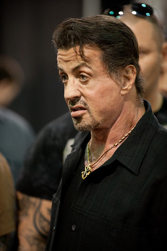 Rocky tattooed by The Wrestler. Sylvester Stallone and Mickey Rourke Sylvester Stallone Shows Off New Ink stock photo : New Age Tattoo Background