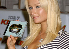 lexi sayok paris hilton holding anxious CD in hand press red carpet utah devan bailey