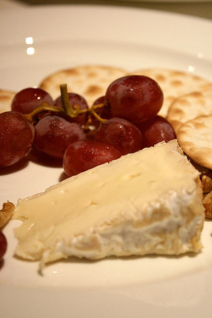 Brillat-Savarin Single Cheese Serving with Walnuts, Seedless Grapes and Crackers