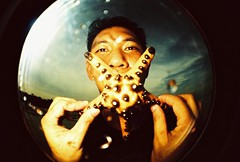 bj with his sea star mouth (darkcanopy) Tags: portrait people film beach analog fun xpro lomography crossprocessed starfish kodak crossprocess philippines wide lofi slide fisheye bohol analogue fe ph elitechrome  lomograph seastar panglao lowfi lsi  funshot fe2 fisheye2 xprod ebx lomographyfisheye 170degrees 170 lsifisheye elitechromeextracolors elitechromeextracolors100