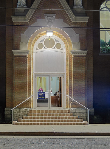 Saint Damian Roman Catholic Church, in Damiansville, Illinois, USA - view through front door at night