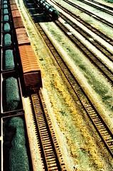 Yards & Rails (| skyscraper |) Tags: city urban film analog yard train xpro crossprocessed grain rails coal railyard richmondva elitechrome100 minoltax570 50mm17