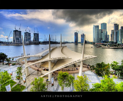 Dark Clouds over Singapore Esplanade :: HDR (:: Artie | Photography ::) Tags: reflection skyline architecture modern clouds photoshop canon buildings singapore waterfront cs2 performingarts wideangle stormy handheld 1020mm hdr artie marinabay superstructure 3xp theatresonthebay sigmalens photomatix tonemapping tonemap si