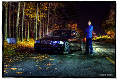 ///M3: Lot 2 (Proleshi) Tags: auto road street nightphotography trees portrait black reflection guy fall leaves car night standing umbrella stand nikon streetlight automobile dusk streetlights fallcolors awesome sb600 lot carlos best german transportation bmw vehicle bluejeans m3 asphalt blueshirt hdr highdynamicrange sportscar roadway yellowline crossedarms d60 firstattempt dottedline strobist bluecanvas onestrobe besthdr proleshi