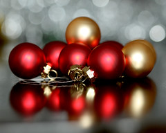 Christmas - A hint of gold (Mukumbura) Tags: santa christmas xmas decorations red party chimney reflection tree glass crimson glitter dinner silver ball scarlet festive season table reindeer fun gold navidad holidays dof bright bokeh decoration vivid balls noel celebration ornaments tinsel santaclaus merry sleigh globes nativity baubles christmasahintofgold gettyholidays2010