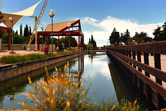 . (Vasilis.) Tags: bridge blue sky water grass clouds river wooden nikon view shot walk greece walker waters griechenland reflexion ellada  feflexion  d700