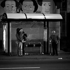 91 Owl (Super G) Tags: sanfrancisco california street people blackandwhite bw woman man night square nightshot candid busstop busroute 50mmf18 atthebusstop stocktonst 91owl monochromemonday standingintheheadlightsstaringattheapproachingbus andireallyshouldhaveusedthetripod