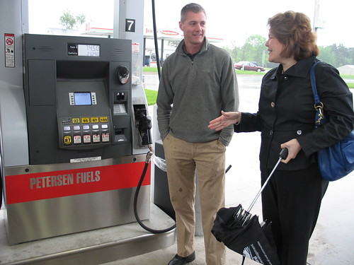 Michael Peterson, owner of Petersen Oil in Greenville, discusses flex fuel pumps at his facility with USDA Rural Business Administrator Judith Canales.