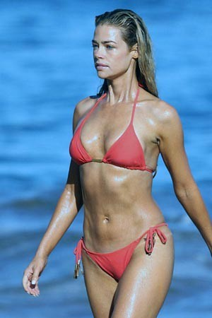 Denise Richards stunning in red hot bikini