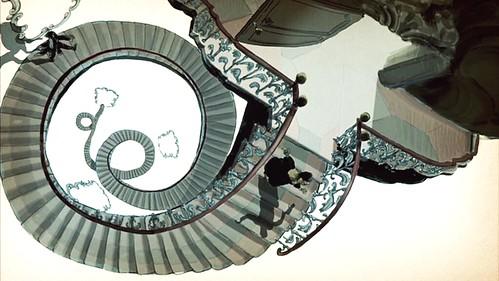 mrshendersonpresents_openingcredits_spiralstairs