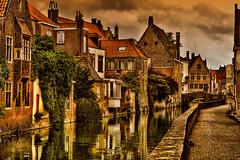 Canal scene in Bruges, Belgium (Anguskirk) Tags: bridge building tree water canal belgium belgie brugge bruges creeper cobbles picturesque 2009 waterway belge topazadjust oldhoses
