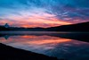 coniston (Kitenutuk) Tags: pink sunset red sky orange cloud sun reflection water clouds sunrise reflexions superaplus aplusphoto