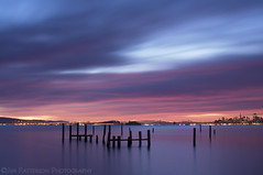 The Sunrise Blues - Sausalito, California (Jim Patterson Photography) Tags: ocean sanfrancisco california city longexposure pink blue sea sky seascape nature water clouds sunrise landscape photography dawn lights bay coast marine pacific cove tripod smooth shoreline wideangle hills coastal shore lee baybridge coastline alcatraz pilings sausalito gitzo daybreak reallyrightstuff oldpier remoterelease nikkor3570mm graduatedneutraldensityfilter nikond300 ostrellina markinsm20ballhead jimpattersonphotography jimpattersonphotographycom goldenblog2010 seatosummitworkshops seatosummitworkshopscom
