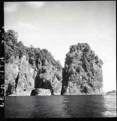 Cliffs and rock islands off the west coast of Kahatola Island, South Loloda Bay