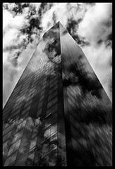 Tower of Power (feijeriemersma) Tags: nyc newyorkcity sky bw cloud white newyork money black tower skyscraper blackwhite power cloudy manhattan bank system cash business wallstreet trump financial crisis scraper finance mortgage patzer financialcrisis