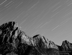 Cascade (Sudheendra Kadri) Tags: winter sky blackandwhite cliff moon mountain face rock landscape star utah trail moonlit startrail sudheendrakadri