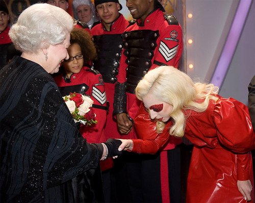 Lady Gaga bowing to The Queen