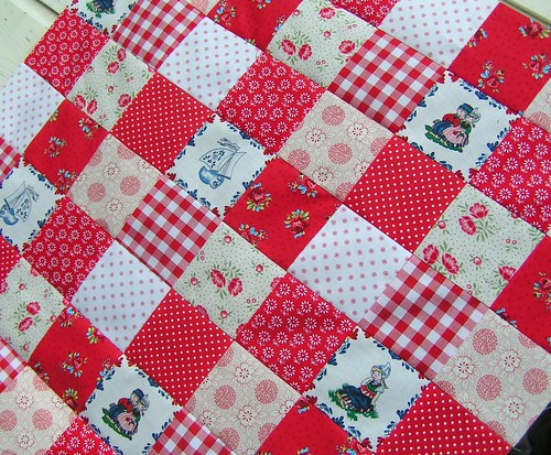 red and white fabric quilt