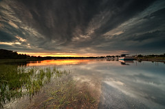 Bass River Sunset (Cape Cod) (Philipp Klinger Photography) Tags: trip travel light sunset shadow vacation sky orange usa cloud sun storm west reflection green art luz nature water grass weather clouds america river landscape geotagged ma grey boat us nikon ship unitedstates bass lumire capecod massachusetts united unitedstatesofamerica von apocalypse dramatic filter cape thunderstorm states dennis yarmouth amerika cod philipp spiegelung apocalyptic graduated neutral staaten klinger barnstable gnd vereinigte aplusphoto d700 vanagram filamwaldorfmdusa