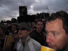 Lovebox Weekender (russelljsmith) Tags: uk friends england sky people music london wearing sunglasses festival dark fun concert victoriapark couple europe skies audience cloudy gig event drinks drunks anticipation 2009 clowds lovebox loveboxweekender 77285mm loveboxweekender2009 lovebox2009 lastfm:event=861454