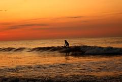 (SamGallagher) Tags: ocean sunset shadow summer sky orange sun black reflection beach water clouds sunrise landscape newjersey surf waves alone glare shadows edited surfer sony horizon nj shore lonely dslr oceancity a300 sonya300
