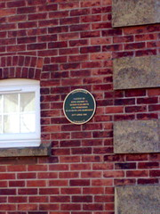 Photo of George VI, Elizabeth II, and Margaret green plaque