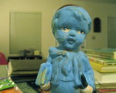 blue boy (giveawayboy) Tags: blue boy statue umbrella ceramic book september figurine curio paintover