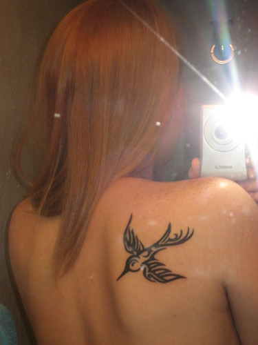 Sylvia Go-Go and birdy tattoo selfshot shoulder
