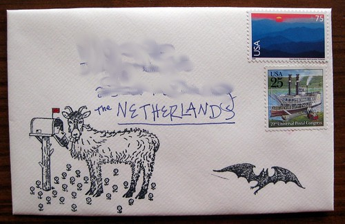 Goat eats mail stamp