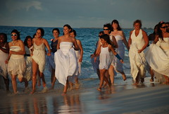 Brides Running On The Beach