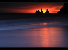 Pinnacles of Vk  Mrdal (orvaratli) Tags: ocean travel sunset red sea cliff seascape beach water sunrise landscape lava iceland sand south atlantic arctic pinnacle vk icelandic vkmrdal arcticphoto rvaratli orvaratli